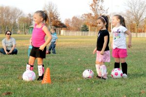 young girls practicing soccer
