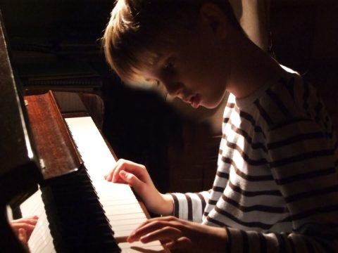 boy practicing the piano