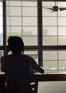 photo of girl studying from behind her